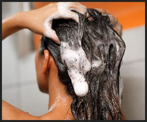 Girl Using Shampoo