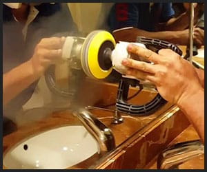 Cleaning Mirror With Metal Polisher