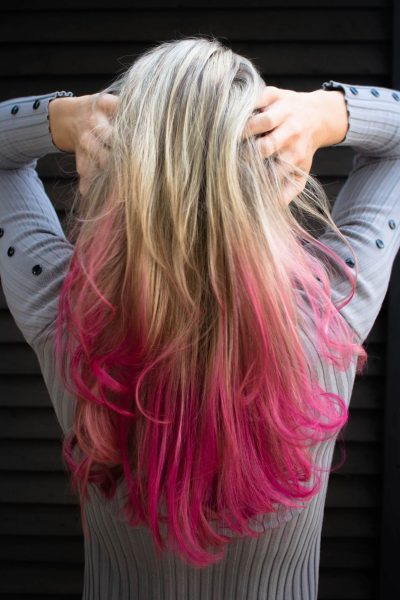 Woman with blonde and pink hair