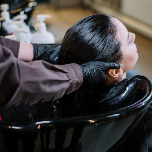A person doing haircare treatment