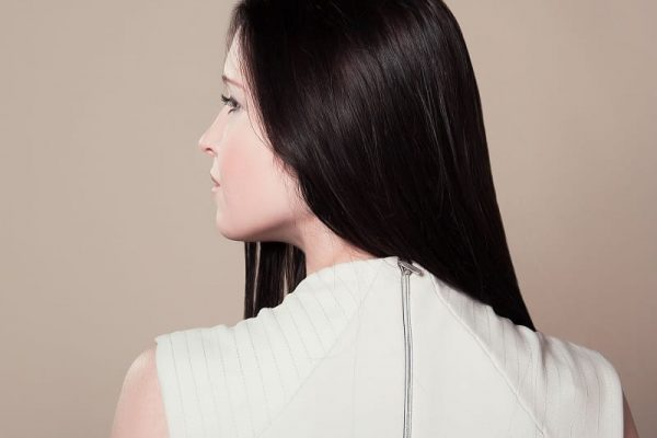 Woman with a straight black hair